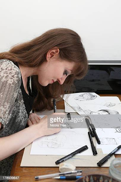 an illustrator working on illustrations