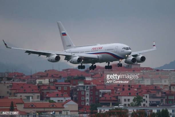 An Ilyushin Il96300PU presidential aircraft with Russian President Vladimir Putin on board to attend the 2017 BRICS Summit flares for landing at the...