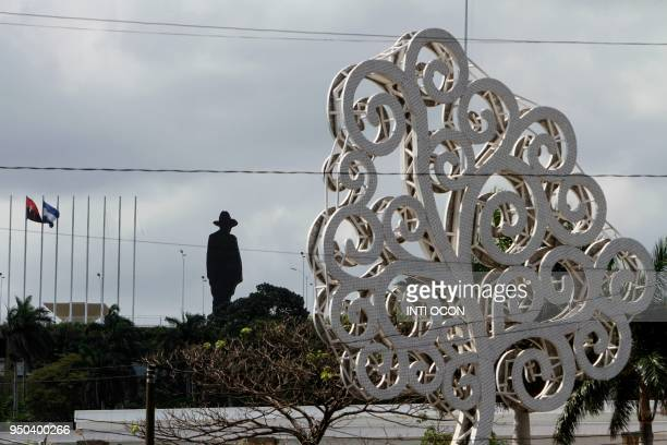 An image depicting Nicaraguan hero Augusto Cesar Sandino and a 'Tree of life' are pictured in Managua on April 23 2018 The 'trees of life' are large...