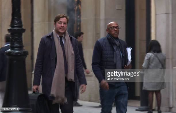 An image grab from an AFP TV video shows International Olympics Committee member Frankie Fredericks arriving at the financial crimes court building...