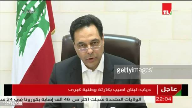 An image grab from footage obtained from Lebanese public television network Tele Liban on August 4, 2020 shows Prime Minister Hassan Diab speaking in...