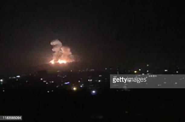 An image grab shows on November 20, 2019 smoke and fire billowing during a reported Israeli air strike on the outskirts of Damascus. - The Israeli...