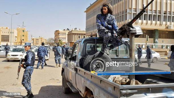 An image grab taken from a video from AFPTV on February 6 shows Forces loyal to Libyan strongman Khalifa Haftar patroling in downtown Sebha the...