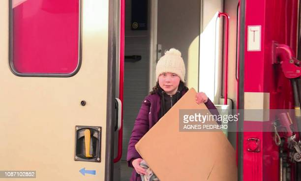 An image grab taken from a video from AFPTV on January 23 2019 shows Swedish youth climate activist Greta Thunberg arriving by train during the World...