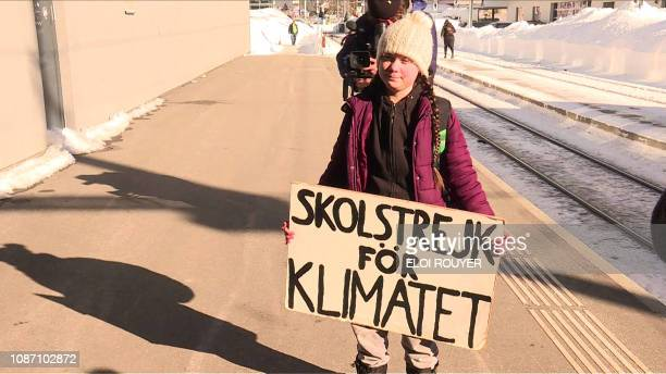 An image grab taken from a video from AFPTV on January 23 2019 shows Swedish youth climate activist Greta Thunberg standing on the platform after...