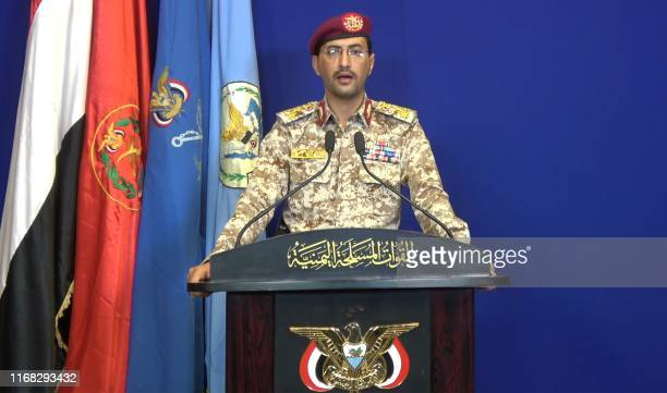 An image grab taken from a video made available by alHuthi Media Office shows Huthi military spokesman BrigadierGeneral Yahya Saree speaking at a...