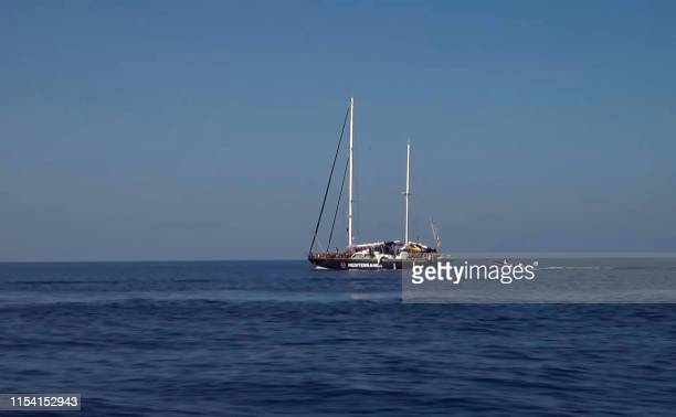 An image grab taken from a video released by Local Team on July 6 2019 shows a charity rescue sailboat heading towards the Lampedusa island on the...