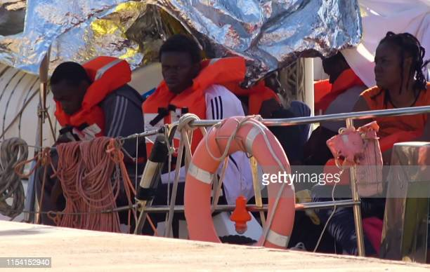 An image grab taken from a video released by Local Team on July 6 2019 shows migrants at the harbour of the Lampedusa island on the Mediterranean Sea...