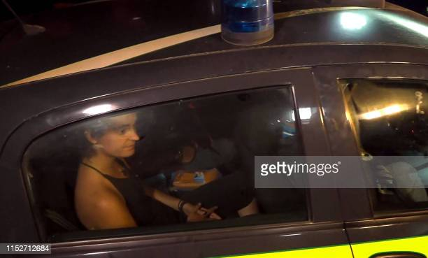 An image grab taken from a video released by Local Team on June 29 shows the SeaWatch 3 charity ship's German captain Carola Rackete being arrested...