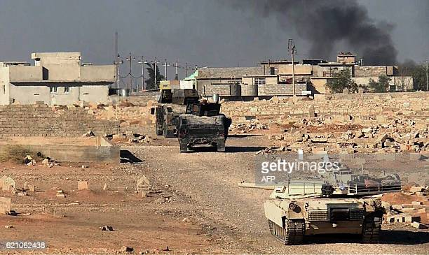 An image grab taken from AFPTV shows an Iraqi forces M1 Abrams tank and armoured vehicles entering the AlKaramah district of eastern Mosul on...