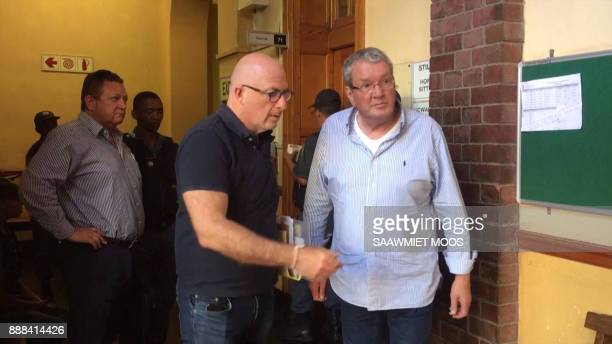 An image grab taken from AFPTV video footage shows convicted Dutch arms dealer Guus Kouwenhoven walking out of a courtroom in Cape Town on December 8...