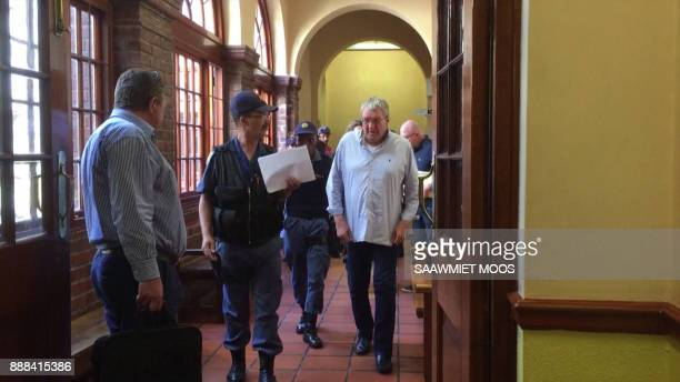 An image grab taken from AFPTV video footage shows convicted Dutch arms dealer Guus Kouwenhoven walking through a corridor in a courthouse in Cape...