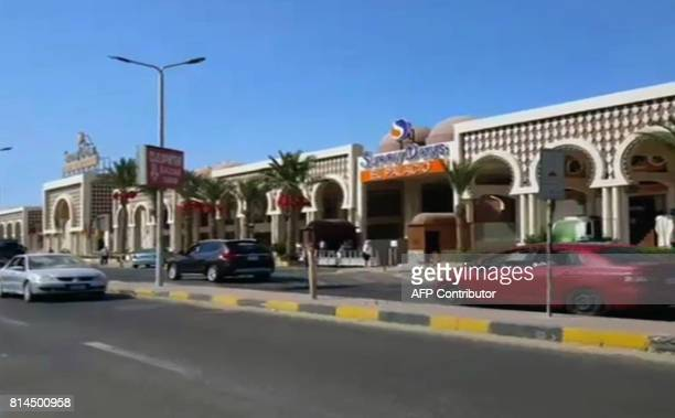 An image grab taken from an AFPTV video shows the road outside a hotel along the beach promenade where a stabbing attack took place in the Red Sea...