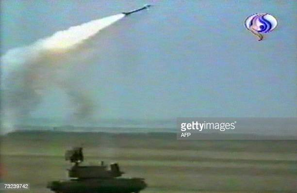An image grab taken from footage shown by the Iranian AlAlam TV shows Iran's elite Revolutionary Guards firing a new Russianmade air defence missile...