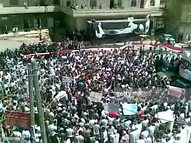 An image grab taken from footage uploaded on YouTube shows hundres of anti-regime protesters demonstrating in the southern Syrian city of Daraa on...