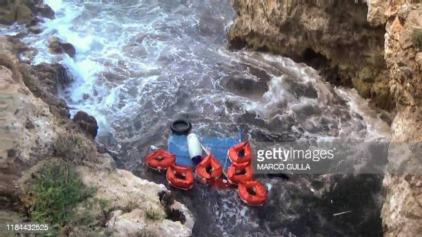 An image grabbed from a video shows on November 24, 2019 buoys washed ashore following the shipwreck of a boat that was transporting migrants, which...