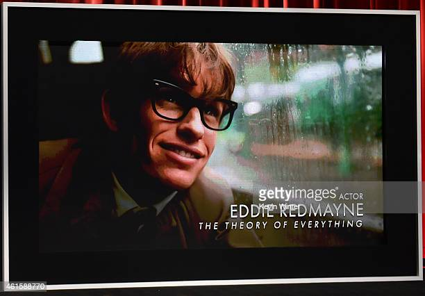 An image is displayed on a big screen onstage of Best Actor nominee Eddie Redmayne for his role in the film 'The Theory of Everything' at the 87th...