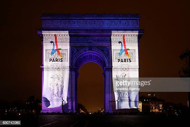 An image is projected on the Arc de Triomphe monument during a laser and 3D video mapping show on the theme of the Paris bid for the 2024 Olympic...