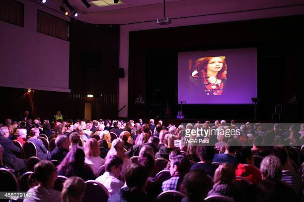 An image is projected to an audience during a public memorial service in memory of murdered schoolgirl Alice Gross held at Greenford Town Hall on...