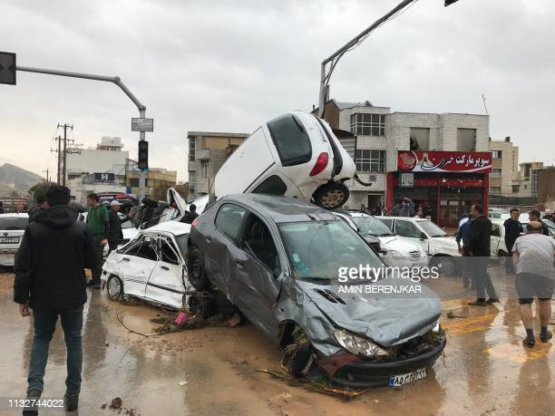 An image made available by Iran's Mehr News agency on March 25 shows cars pilling up in a street in the southern city of Shiraz. - At least 12 people...