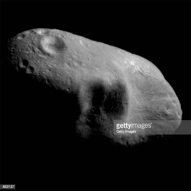 An image mosaic of the asteroid Eros with sunlight coming from the northeast taken by the robotic NEAR Shoemaker space probe March 3 2000 from a...
