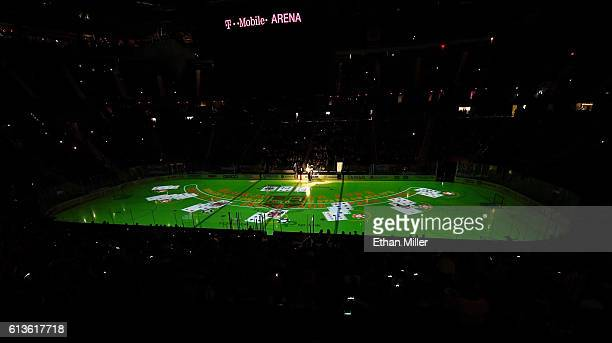 An image of a blackjack table is projected on the ice before a preseason game between the Colorado Avalanche and the Los Angeles Kings at TMobile...