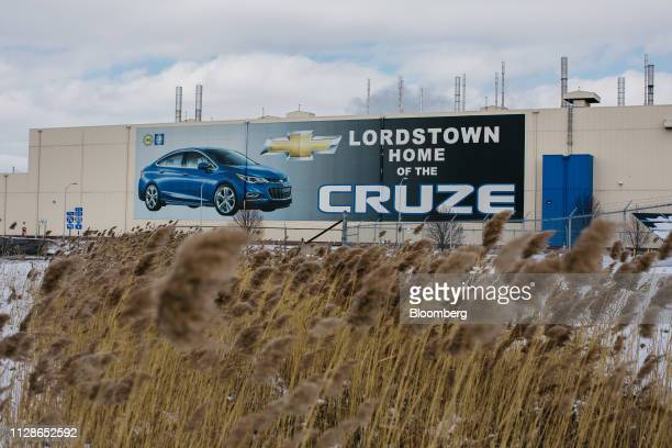 An image of a Chevrolet Cruze vehicle is displayed outside the General Motors Co Lordstown production plant complex in Lordstown Ohio US on Monday...