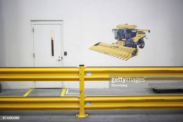An image of a combine harvester is displayed on a wall at the CLAAS of America Inc production facility in Omaha Nebraska US on Wednesday June 6 2018...