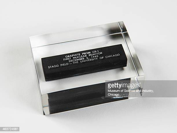 An image of a commemorative graphite section sealed in acrylic saved from the world's first self sustained nuclear reaction engineered by physicist...