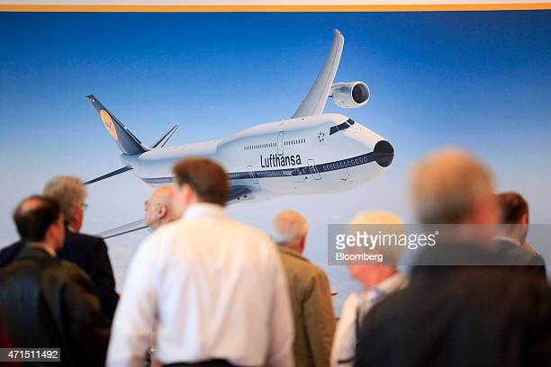 An image of a Deutsche Lufthansa AG passenger plane sits on a display banner as shareholders attend the airline's annual general meeting in Hamburg...