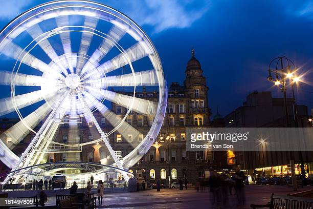 CONTENT] An image of a ferris wheel in Glasgow Scotland