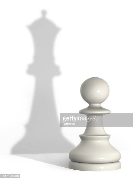 An image of a pawn but a shadow of a queen chess piece