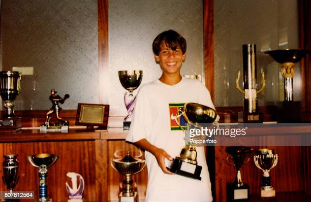 An image of a photograph depicting a young Rafael Nadal with trophies he won in his childhood displayed at the 'Club Tenis Manacor' in Majorca Spain...
