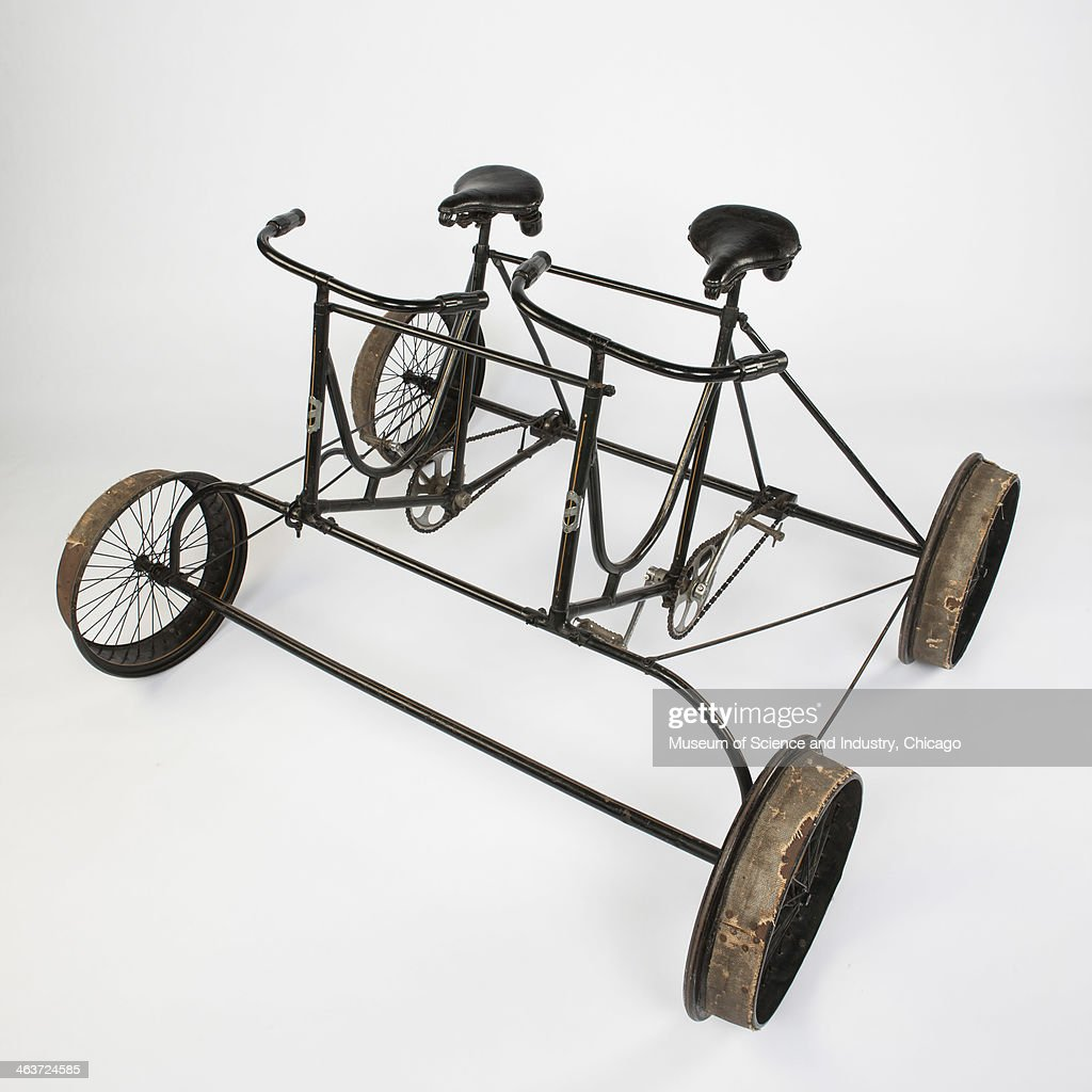 An image of a side by side tandem four wheel bike circa 1885 designed for riding on railroad tracks, from a collection of transportation artifacts at the Museum of Science and Industry, Chicago, Illinois, June 12, 2013.