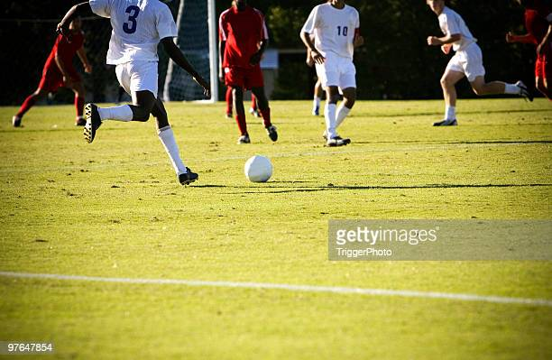 an image of a soccer match in action - rush fútbol americano stock photos and pictures