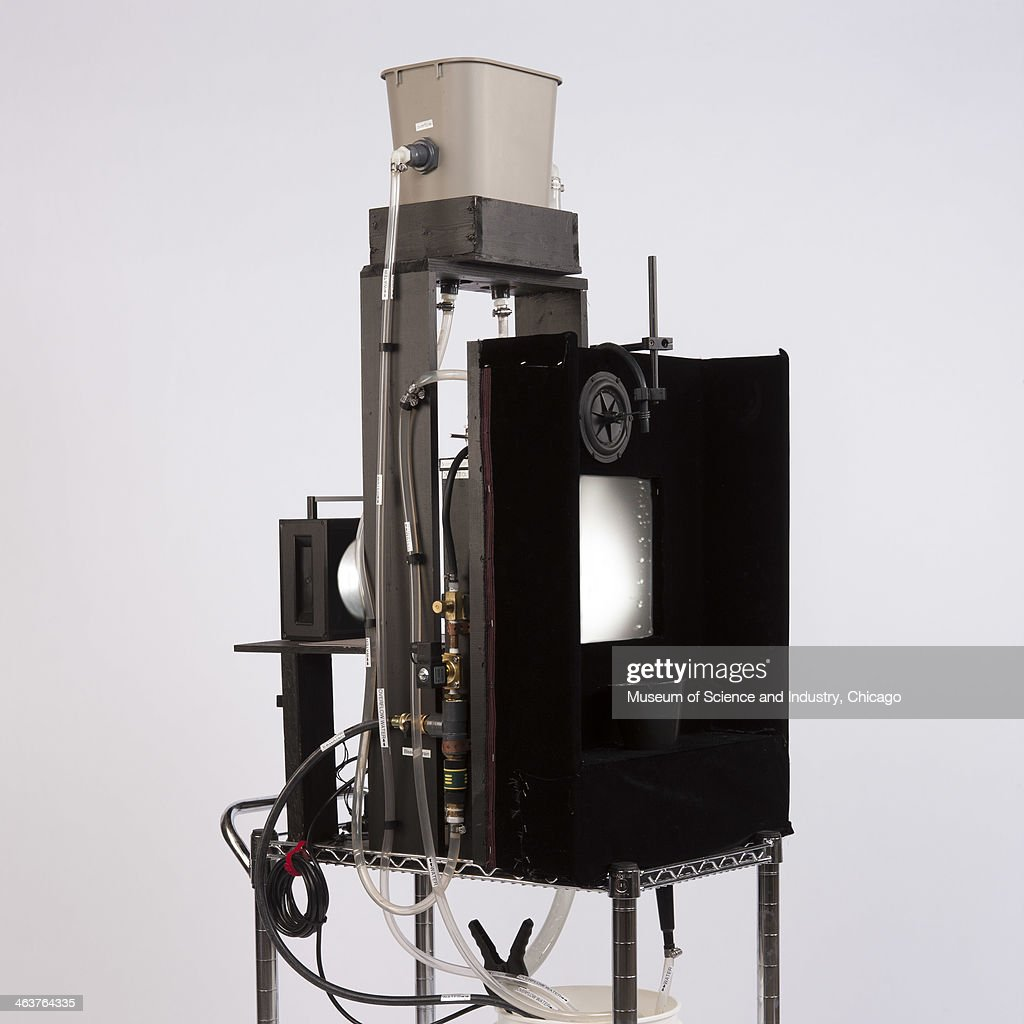 An image of a water drip device made by Heinrich Jaeger and Sidney Nagel of the University of Chicago, a physics demonstration that uses a strobe light to give the appearance that drops of water freeze in mid air, from a collection of scientific equipment at the Museum of Science and Industry, Chicago, Illinois, June 14, 2013.
