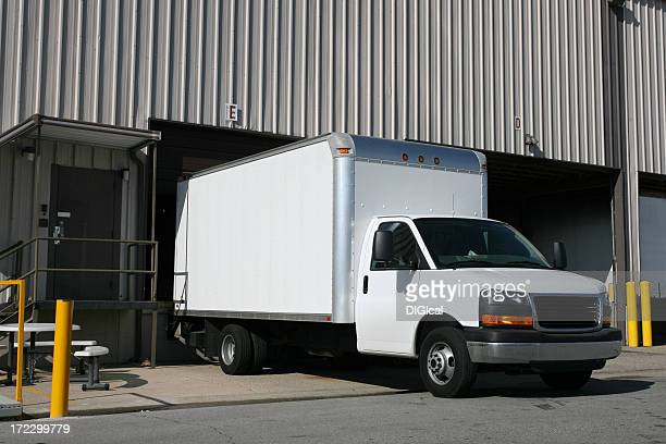 An image of a white delivery truck
