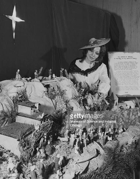An image of a woman admiring the Santons of Provence display at the annual Christmas Around The World festival at the Museum of Science and Industry...