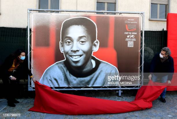 An image of a young Kobe is unveiled as part of a photo exposition, during the inauguration ceremony of a square named after late Los Angeles Lakers...
