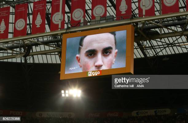 An image of Abdelhak Nouri of Ajax is shown on the screen during the UEFA Champions League Qualifying Third Round match between Ajax and OSC Nice at...