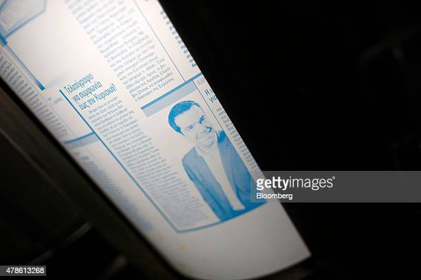 An image of Alexis Tsipras Greece's prime minister sits on a metal print sheet during the printing of a sports newspaper at the Kathimerini...