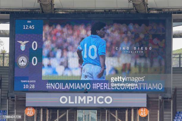 An image of Argentine football legend Diego Maradona is displayed on a giant screen, to pay tribute to him after his death, ahead of the Serie A...