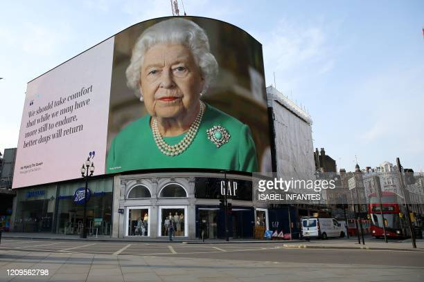 An image of Britain's Queen Elizabeth II making her her address to the UK and the Commonwealth in relation to the coronavirus epidemic is displayed...