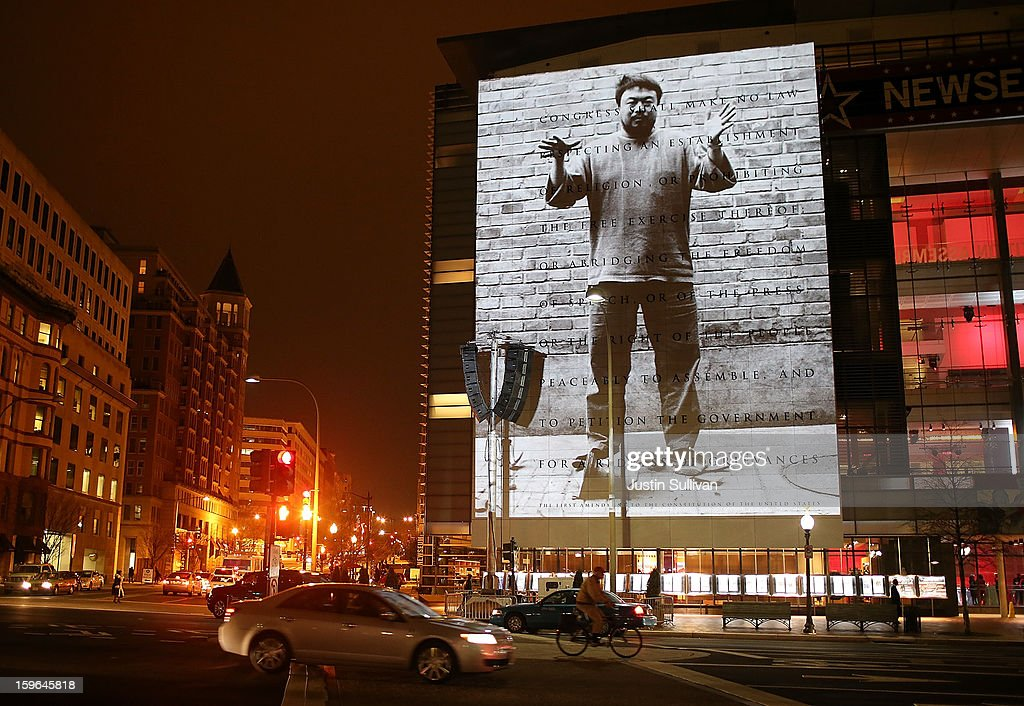 An image of Chinese artist and activist Ai Weiwei is seen projected on a 74-foot-tall marble First Amendment tablet on the exterior of the Newseum on January 17, 2013 in Washington, DC. The exhibit runs 7 p.m. each night through January 17.