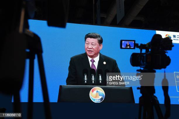 An image of Chinese President Xi Jinping speaking at the opening ceremony of the Belt and Road Forum is seen in the media center of the Forum in...