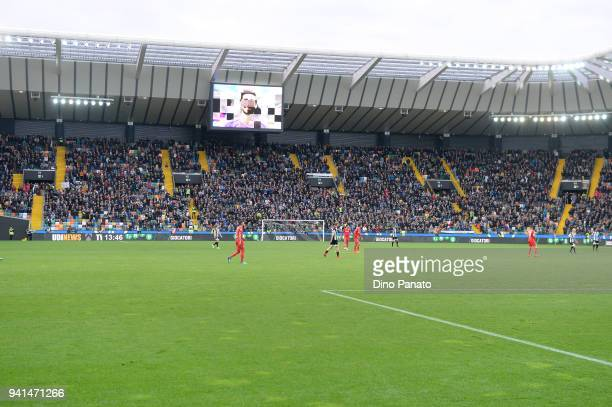 An image of Davide Astori is displayed on the screen during the serie A match between Udinese Calcio and ACF Fiorentina at Stadio Friuli on April 3...