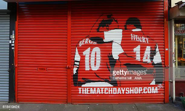 An image of Dennis Bergkamp and Thierry Henry of Arsenal on the shutter of the Matchday merchandise shop close to the stadium after the Emirates FA...