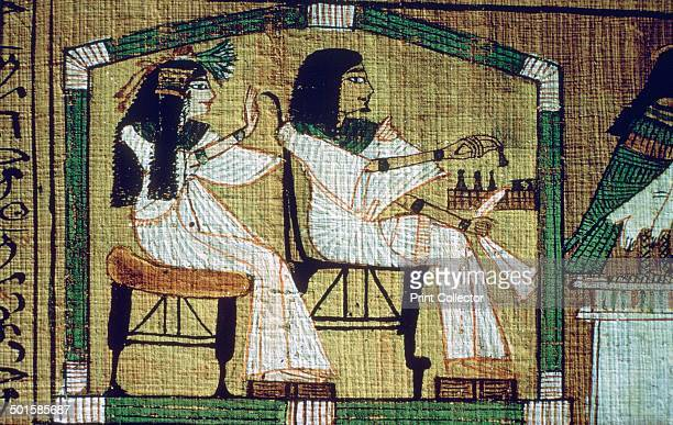 An image of draughtsplaying between Ani and his wife from Ani's Book of the Dead From Thebes From the British Museum's collection
