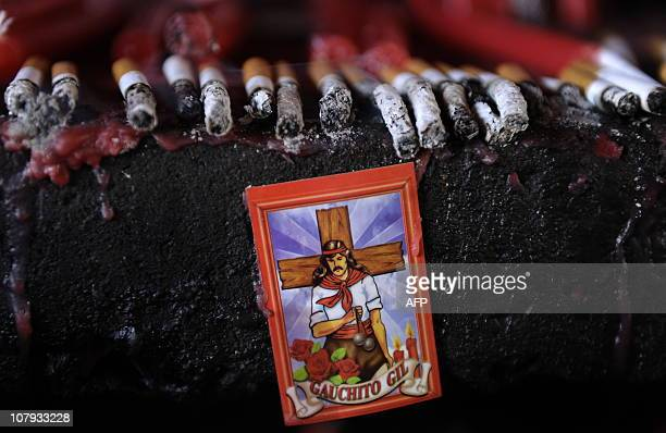 An image of folk saint Gauchito Gil with offers at his sanctuary near Mercedes in the Argentine province of Corrientes on January 8 2011 The cult of...