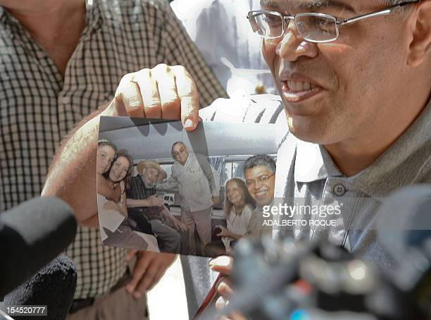 An image of former Cuban President Fidel Castro is held up by former Venezuelan VicePresident Elias Jaua in La Havana on October 21 2012 The...